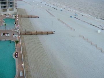 Gulf Shores condo rental - THE VIEW from the balcony at twilight - a jacuzzi is at the end of each pool
