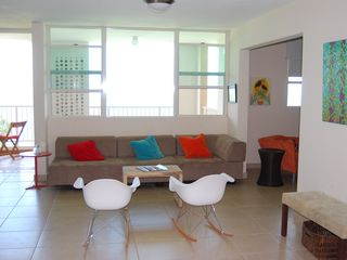 Aguadilla apartment photo - The living area and balcony have an ocean view.