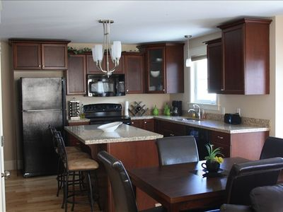 Modern, spacious, gourmet kitchen featuring granite counter tops, new appliances