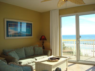 Open & bright living room for relaxing with family & enjoying views of the Gulf