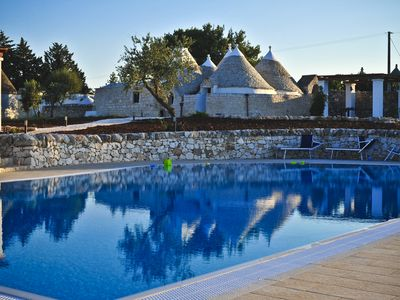 Ostuni villa rental - reflections in the new 15 metre infinity pool with the trullo behind