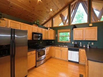 Note the full-sized kitchen in this cabin rental in Gatlinburg -- extra seating