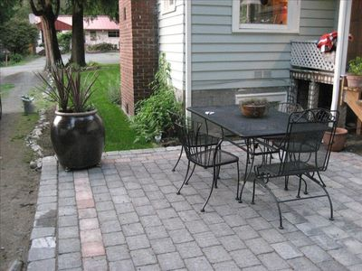 Large rear patio with outdoor seating, built-in fire pit and gas BBQ