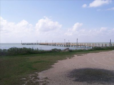 Resident lighted fishing pier on Copano Bay