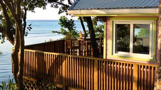 Roatan house photo - Side view of Pink Orchid with wraparound deck