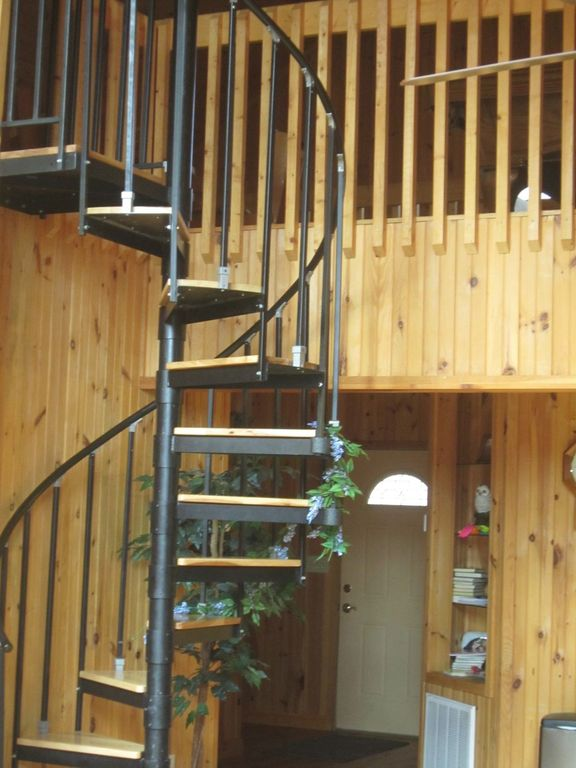 Spiral staircase takes you to the loft where you can play pool or board games.