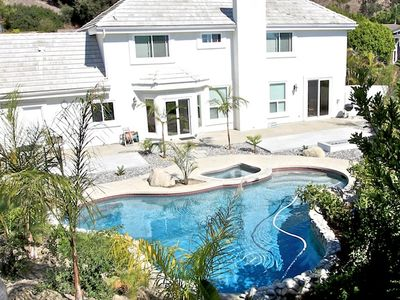View of backyard with spacious pool, jacuzzi, fire pit and dining