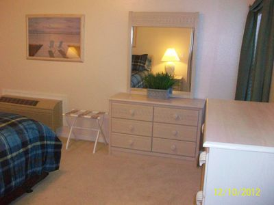 Adjoining guest quartes - queen size bed, private bath, setting room, kitchenet