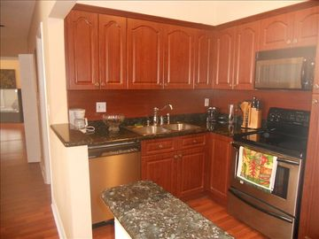 Kitchen is fully equipped with stainless steel appliances