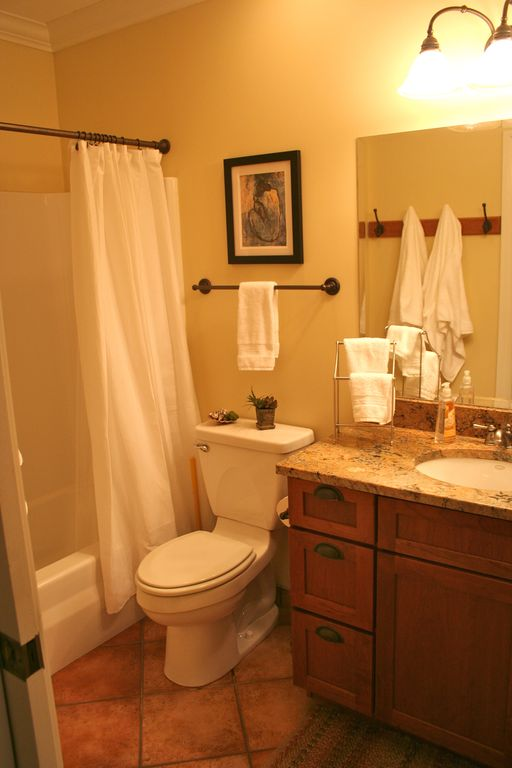 Bathroom with tub and shower and granite countertops
