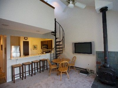 Main floor living area, breakfast bar, flat screen TV