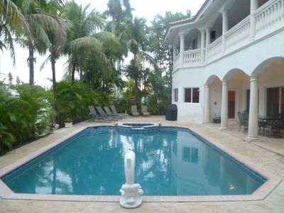 Beautiful backyard with large pool and spa on tropical waterfront setting