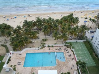 Isla Verde condo photo - Swimming pools, Full size basketball court, playground, bar-b-que area