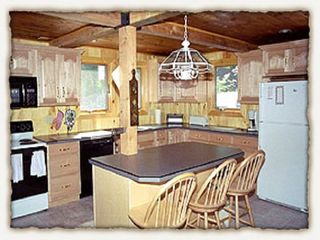 Raymond lodge photo - View of the kitchen. Two refrigerators in the kitchen and 2 in the basement