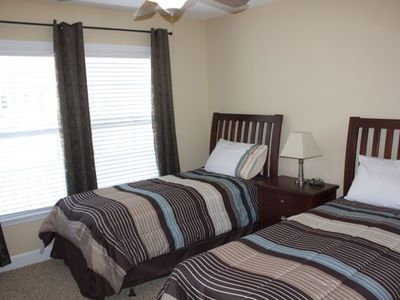 upstairs bedroom with two twin beds and flat screen tv