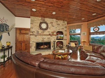 Gatlinburg chalet rental - Main living room with wood burning fireplace, comfy seating & mtn view. 2d floor