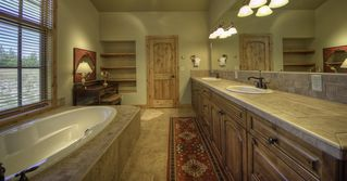 Big Sky house photo - Master bath with large soaking tub, double vanity and shower