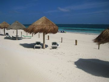 relax in the sun or shade on our beach