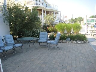 Beach Haven house photo - Ground Level patio w/ Grill. Access to Boat Slip