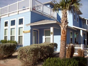 Port Aransas house rental - Front entrance to Serenity Shores with parking along front, side and in driveway