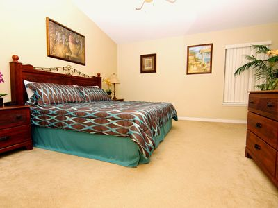 Master en suite bedroom with king size bed and a full size bathroom