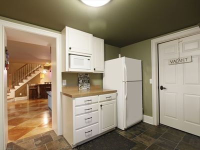 Full kitchen in the basement makes preparing meals easy for patio dining