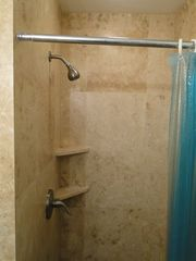 Haleiwa condo photo - new master bath shower in travertine