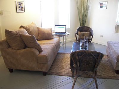 "Living room: Comfortable sofa and chairs, 32"" TV and DVD player, video library"