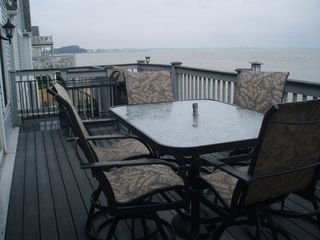 Port Clinton house photo - Deck w/ table, chair, gas grill, spiral roll staircase to beach/porch