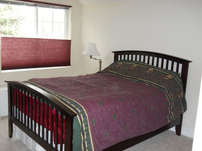 Upstairs bedroom with Full size bed and large walk in cedar lined closet