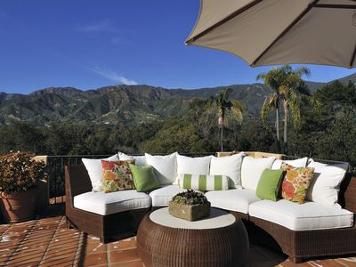 Relax on the outdoor sectional on the rooftop deck, which has both mountain views and a partial ocean view.
