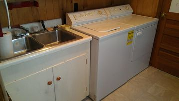 Laundry room: washer, dryer & utility sink off kitchen.