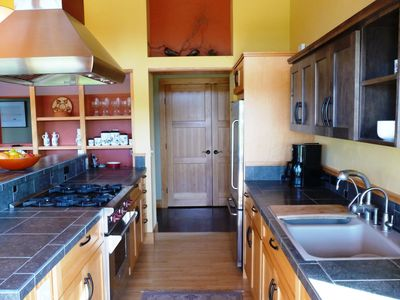 Kitchen with Wolf range and granite tile countertops