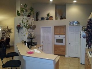 Las Vegas house photo - Fully loaded open kitchen overlooking living room and HDTV,