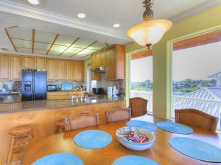 Summer Haven house photo - 3rd floor dining room area. Kitchen has a breakfast bar.