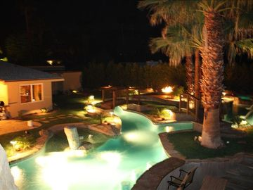 Rancho Mirage house rental - Night photo of pool & lazy rivers from top of slide