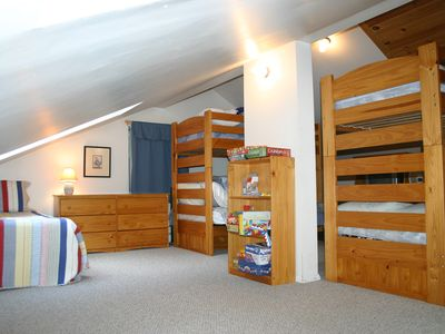 Bunk room with 3 twins and 3 full size beds (one not shown).