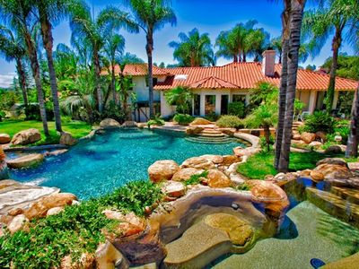Private oasis with private pool, hot tub, and water slide