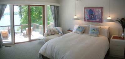 Master bedroom has full lake views and adjoining deck
