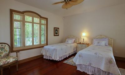 Downstairs bedroom with two twins and access to private porch with ocean view