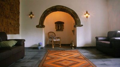 living area with traditional alcove