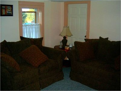"Upstairs Family room with comfy love seats and 24"" TV"