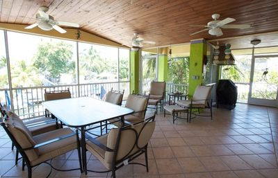 Screened Porch with gas grill and sitting area