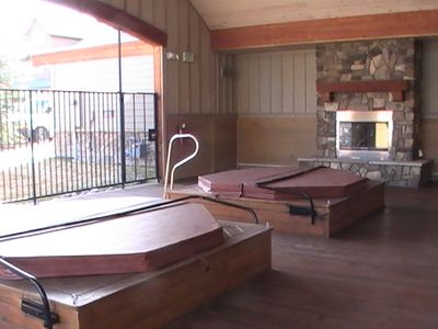 Covered, outdoor hot tubs