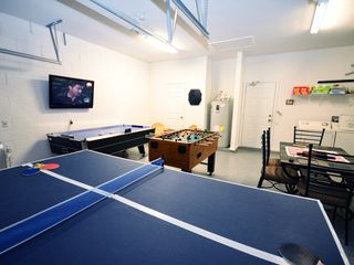 "Windsor Hills villa photo - Game room features air hockey, ping pong and foosball with a 42"" cable TV"