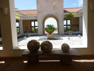 Punta Cana condo photo - Lanai between main lobby and infinity swimming pool/spa area outside.