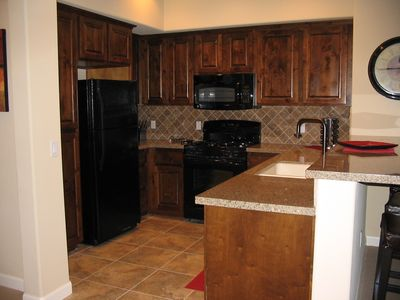 High end luxury with granite counter tops, solid wood cabinets