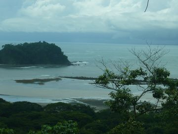 Enjoy this view of Playa Samara, the offshore reef, and the islet of Isla Chora