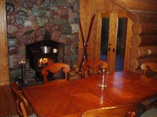 Whitefish cabin photo - Enjoy a romantic dinner in front of the stone fire