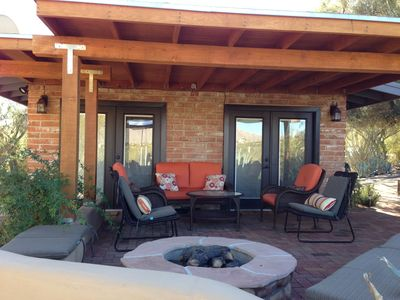 Outdoor covered seating with firepit and gorgeous view of the mountains.